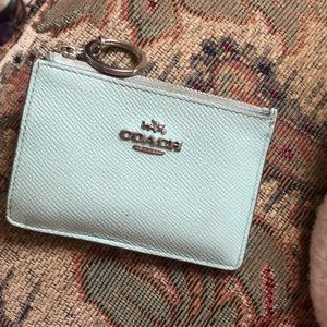 Mint green coach card holder